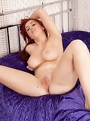 Thicker amateur redhead Amy whips out her big natural tits.