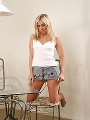 Ashley Steel drops her short skirt to the floor.